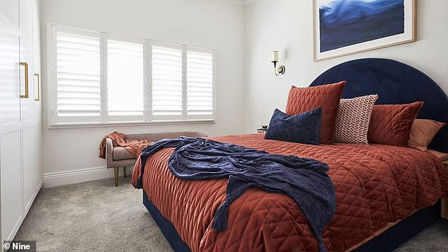 Another curve! One guest bedroom featured a navy curved bedhead