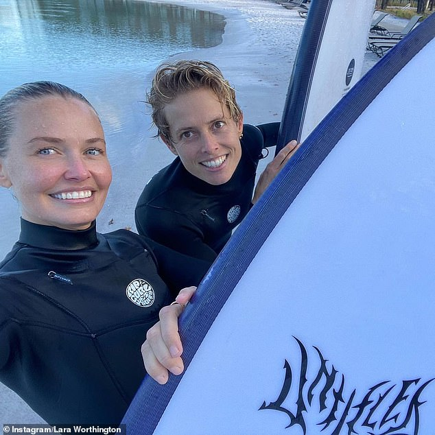 Achievements: 'Happy, proud, thrilled (!) to have taken up surfing with you,' she wrote, tagging her pal Emily Cooper-Given (R) in the happy photograph