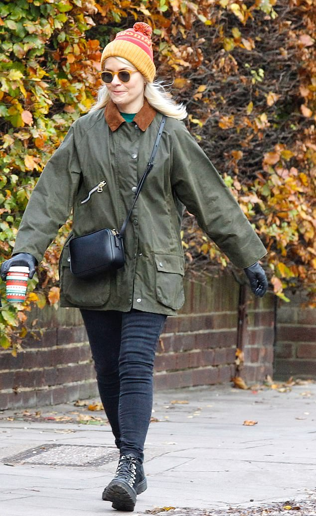 Out and about: The ITV star pulled animated facial expressions as she walked across the streets of the chilly city