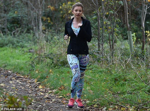 More colour: She finished the look off by choosing more colour with pink and purple running trainers