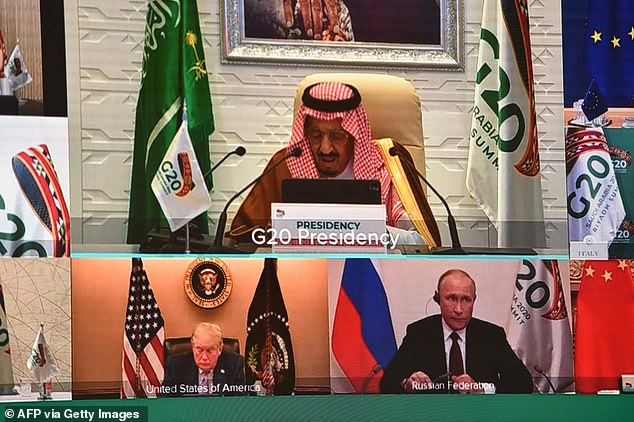 Saudi King Salman bin Abdulaziz Al Saud (top) speaks at the virtual G20 conference Saturday, with President Donald Trump (bottom left) and Russian President Vladimir Putin (right) listening in