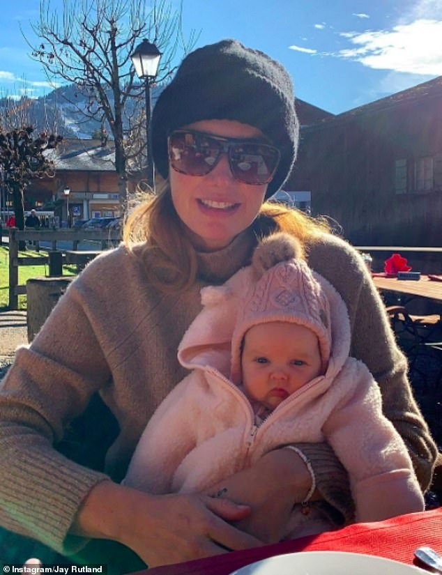 Adorable: Tamara Ecclestone looked ecstatic as she cuddled her two-month-old baby Serena as she enjoyed a tasty meal out at Le Petit Chalet in Switzerland on Sunday