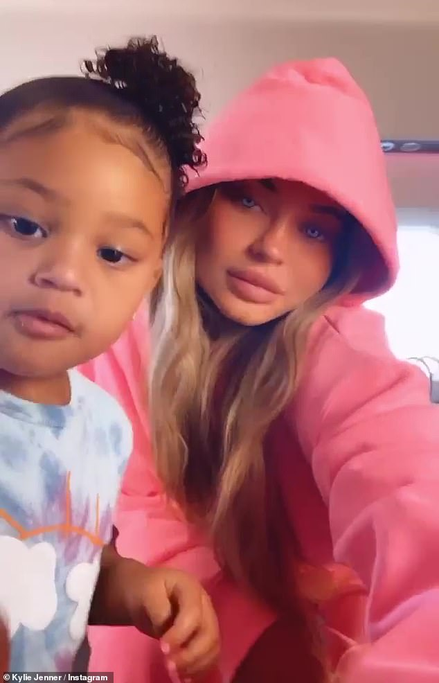 Kylie Jenner uses blue eye filter as she poses in pink hoodie while spending time with Stormi