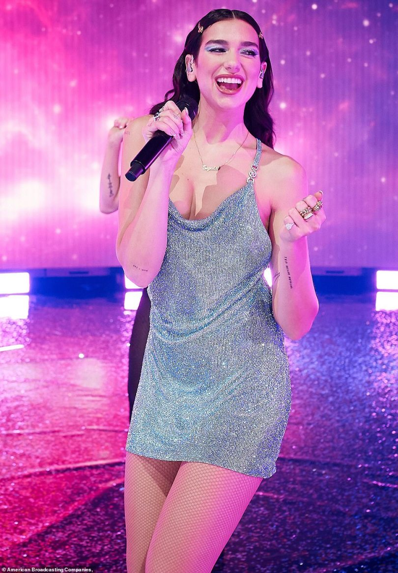 Among the stars: She sparkled in a blue jeweled mini dress, as she put on a show with her matching dancers in front of a cosmo-lit backdrop