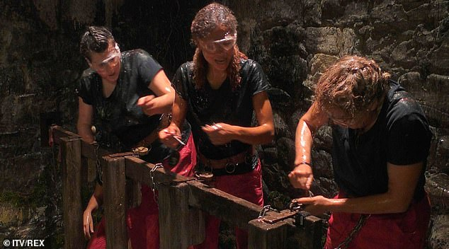 Gruelling: The female celebrities had to unlock their padlocks while being doused in fish guts (pictured)
