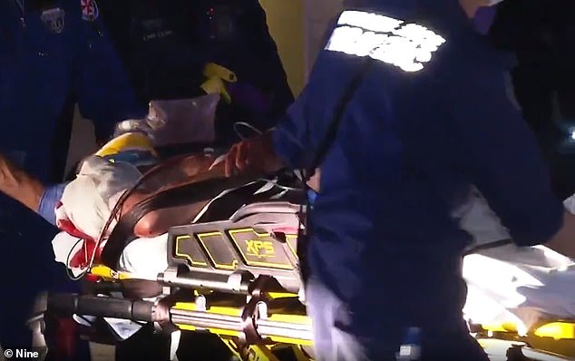 Ball is seen being stretchered out of his mother and stepfather's $3.1 million home in mid-November. He lost two litres of blood, paramedics said