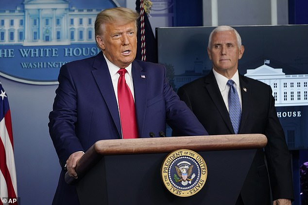 Donald Trump, watched by Mike Pence, delivered a 60-second briefing on Tuesday