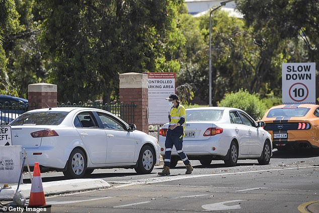 A security guard at the Peppers Hotel has been identified as South Australia's 'patient zero' who ultimately plunged the state into a strict lockdown (pictured, vehicles queuing up for testing)