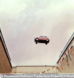 The conversion kit will allow owners of all classic Minis, at least, to keep on motoring in their beloved cars in an eco-friendly way long into the future. However, the car's distinctive high-pitched revs — as famously immortalised in the 1969 film The Italian Job (pictured) — will be lost to the near-silence of the electric engine