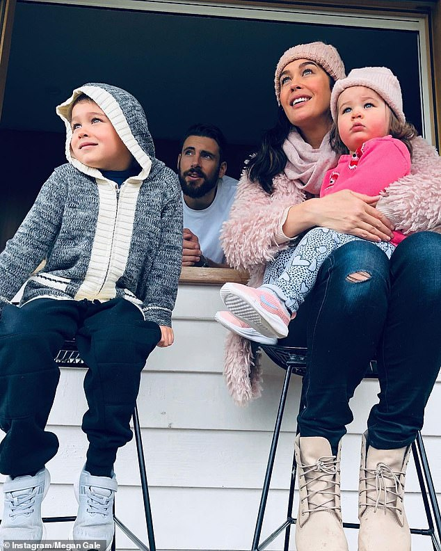 Who's at home: Megan with herfiancé Shaun and two children - River, six, and Rosie, two