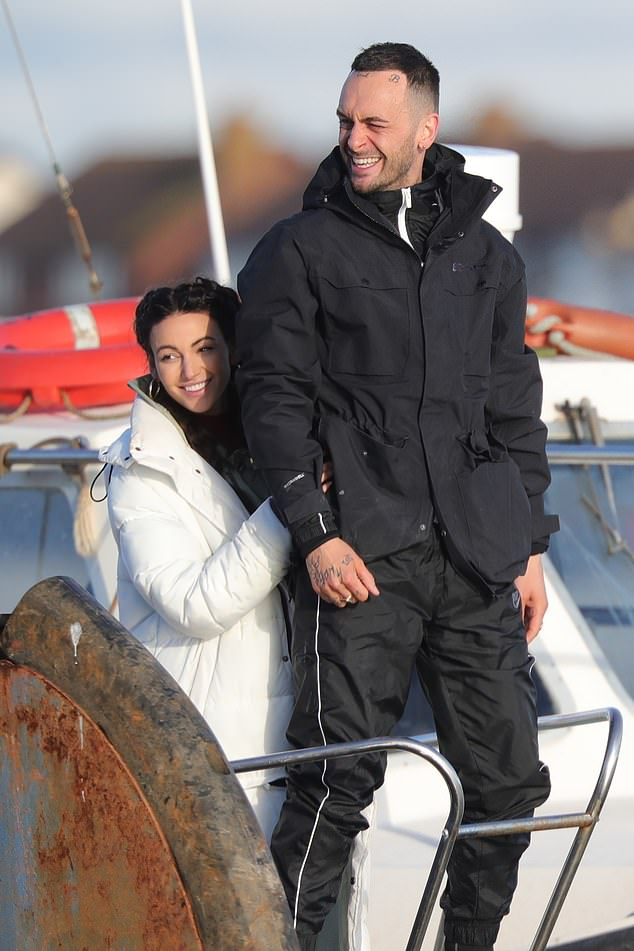 Feeling the chill:Michelle Keegan wrapped up for the chilly November weather as she filmed scenes with Joe