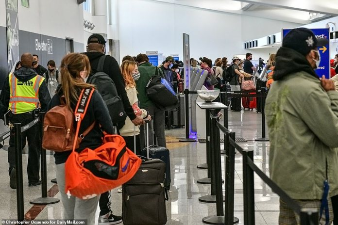 ATLANTA, GEORGIA: Millions of Americans have continued to ignore CDC guidance and dire warnings from public health officials to avoid Thanksgiving travel. Pictured above is the crowd waiting to check in for flights atAtlanta Hartsfield-Jackson International Airport yesterday