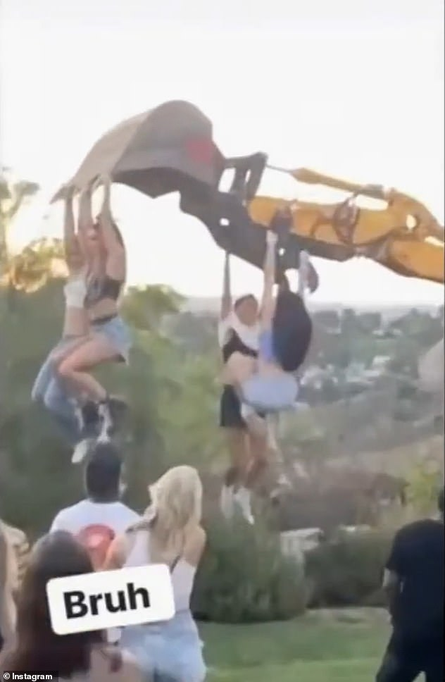 At the party wild attendees were seen swinging from a construction backhoe in the backyard