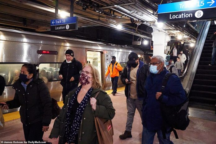 NEW YORK CITY: Passengers get ready to board trains at New York's Penn Station yesterday