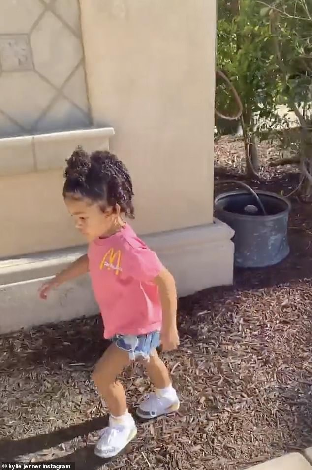 On the run:The child also had on denim shorts and sneakers as her hair was worn half up