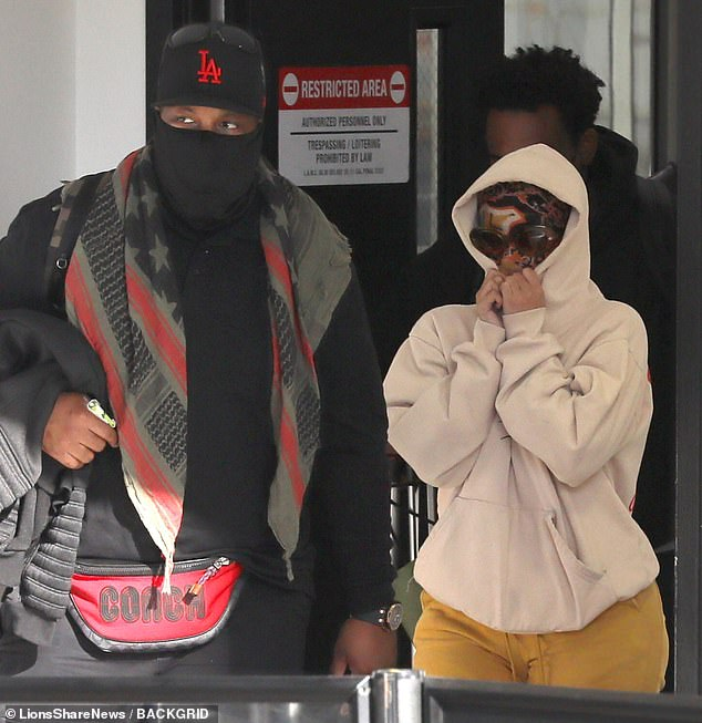 Hidden:As she made her way through security flanked by bodyguards, Cardi had a pair of sunglasses popped on top in an effort to blend in a little better