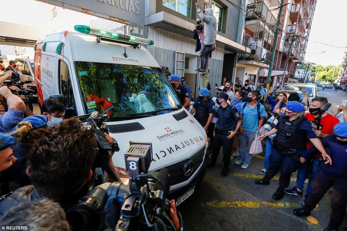 NOVEMBER 11: An ambulance carrying Maradona leaves the clinic where he underwent brain surgery, in Olivos, on the outskirts of Buenos Aires
