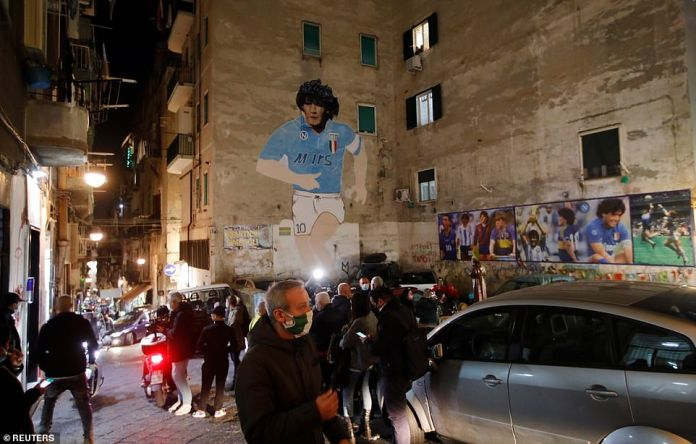 A mural of Argentine soccer legend Diego Maradona is seen in the Spanish Quarter of Naples after the announcement of his death, in Naples, Italy, November 25, 2020