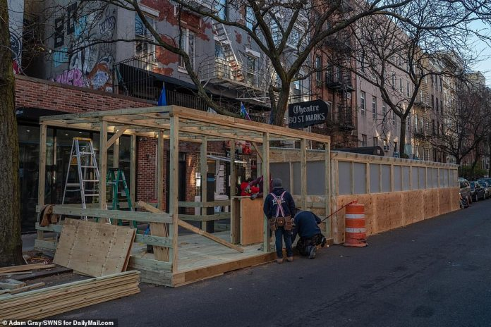 NYC: Workers set up an outdoor patio at a restaurant in Manhattan's East Village on November 20