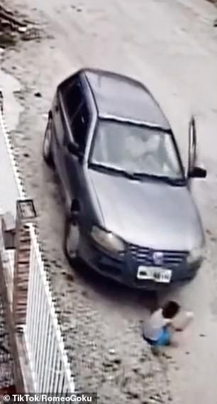 A car unknowingly drove into a little boy
