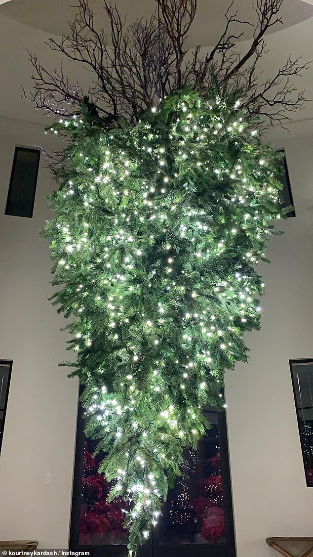 Unique: In the foyer was a large Christmas tree decorated with white lights - and hung upside with the roots reaching her ceiling