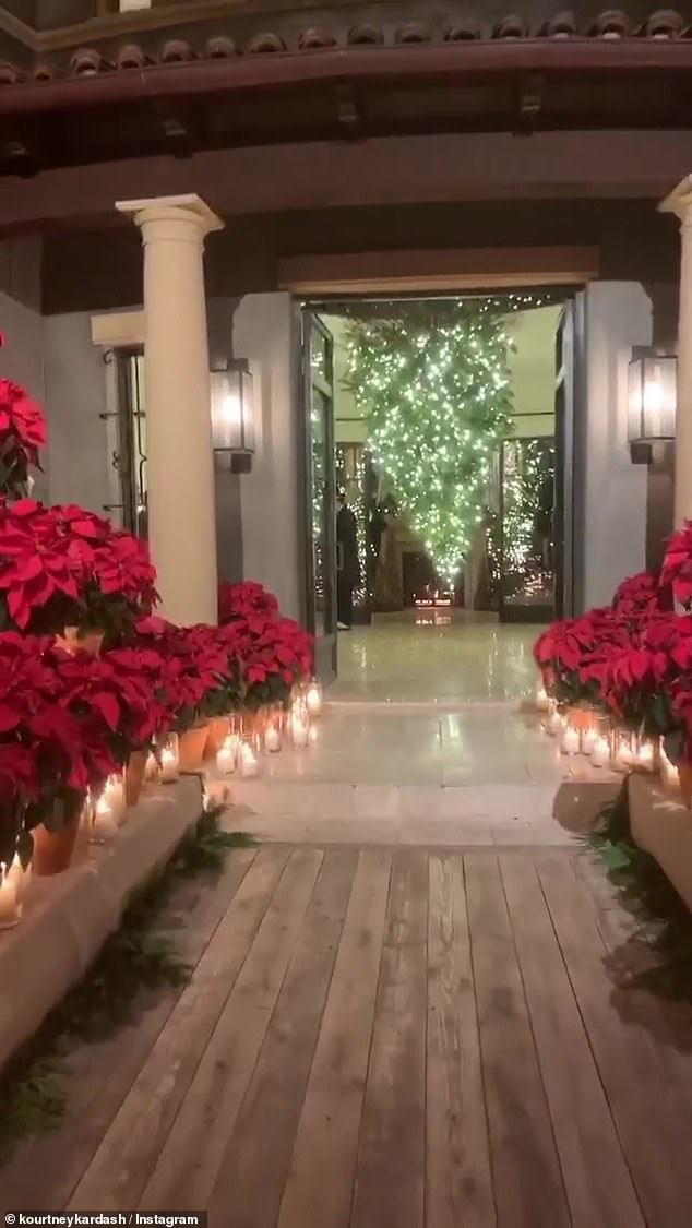 Impressive: She gave a tour of the set up last year, which included a poinsettia lined walkway leading into her 12,000 square foot home