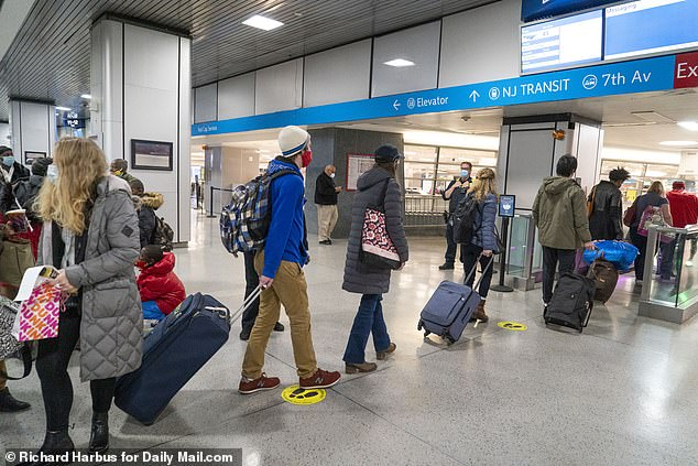 NYC travelers departing from Penn Station despite the warnings against travel