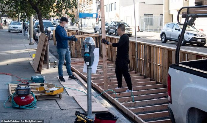 SAN FRANCISCO: Workers set up a new outdoor dining structure in San Francisco on Tuesday