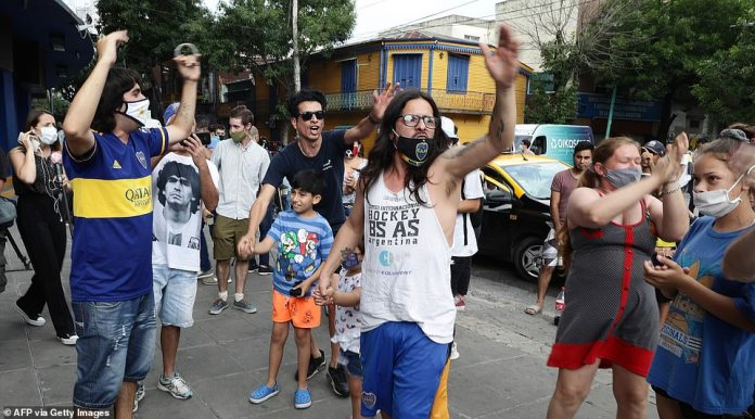 Mourners sing slogans outside La Bombonera, the stadium of Boca Juniors where Maradona used to play