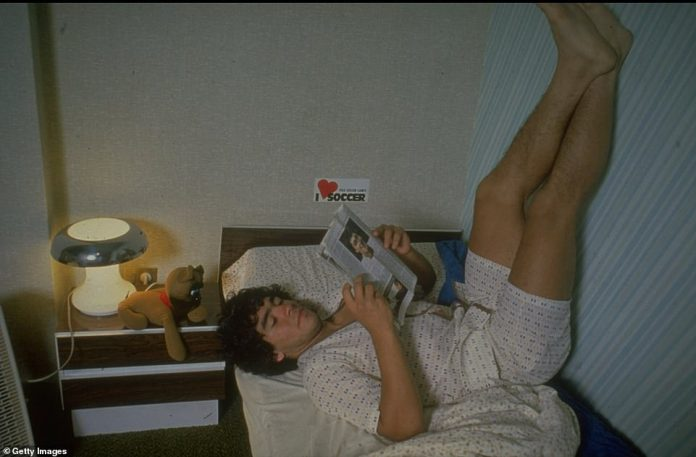 A 20-year-old Maradona resting on his bed at home reading a magazine