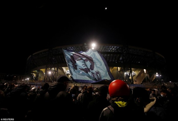 People gather to mourn the death of Argentine soccer legend Diego Maradona outside San Paolo stadium in Naples, Italy, November 25, 2020