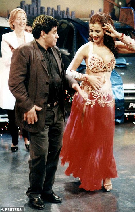 Maradona displays his dancing skills with Turkish bellydancer Tanyeli in a televised entertainment programme in Istanbul