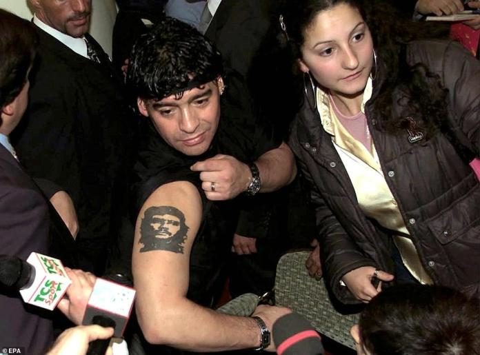 Maradona shows his tattoo of Marxist guerrilla fighter Ernesto 'Che' Guevara during a press conference in Rome, Italy, 12 January 2001