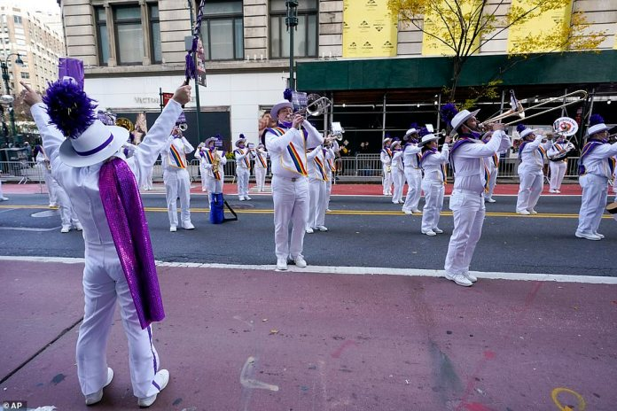 A marching band rehearses along 34th Street during a pre-taping of the Macy's Thanksgiving Day Parade