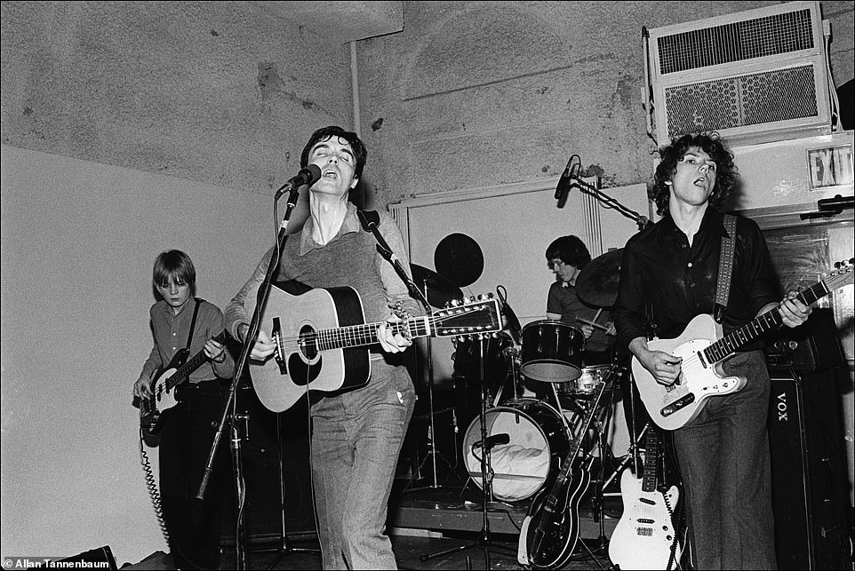 The Talking Heads were formed in 1975 and released their first album two years later. Above,The Talking Heads - Tina Weymouth, David Byrne, Chris Frantz, drums, and Jerry Harrison - perform at The Lower Manhattan Ocean Club, NYC, 1977. Ocean Club was one of Mickey Ruskin's spot and Tannenbaum explained that the venue, which was at Chambers and Church in Tribeca, wasn't open long. However, Ruskin's Max's Kansas City was around for years and artists, from Andy Warhol to Roy Lichtenstein, went to the nightclub. The Talking Heads had mainstream success in the 1980s with their single, Burning Down the House