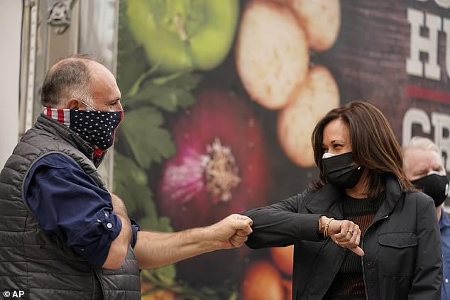 Kamala Harris and Chef Jose Andres exchange an elbow bump