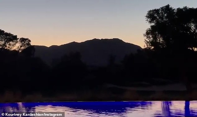 Beautiful sunset: She also shared a quick clip of the gorgeous mountainous sunset view from her infinity pool to her Instagram Story