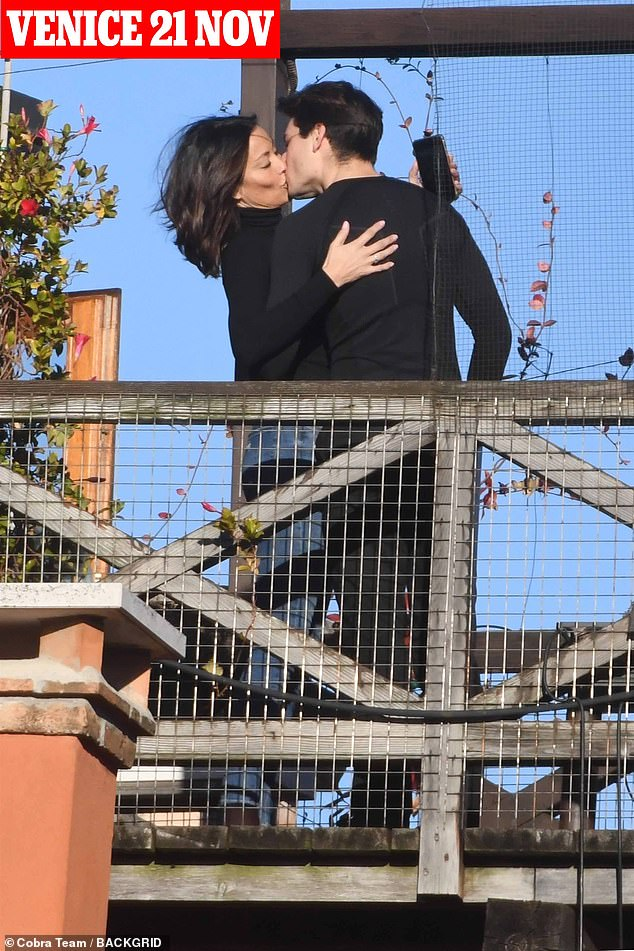 PDA-OMG! Melanie, 50, was snapped in Venice visiting gondolier Riccardo Simionato, 23, pictured fawning all over him in very public displays of affection