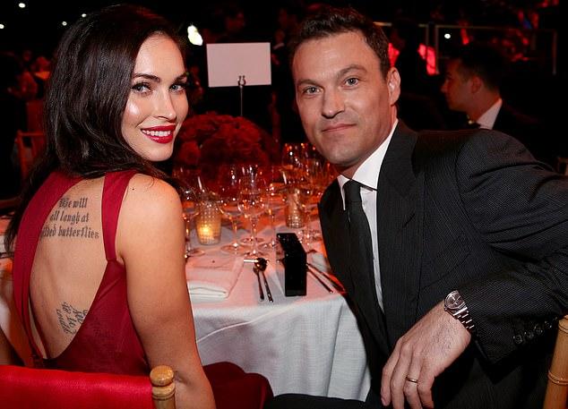 A medida que pasa el tiempo: el dúo ardiente aparece en una gala de Ferrari en 2014, el año antes de que Megan solicitara el divorcio por primera vez.