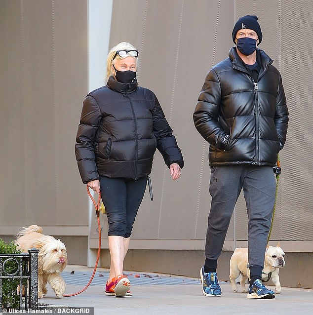 Strolling:Hugh Jackman, 52, and his wife Deborra-Lee Furness, 64, looked like the ultimate pair on Wednesday afternoon as they strolled our the Big Apple with their beloved dogs