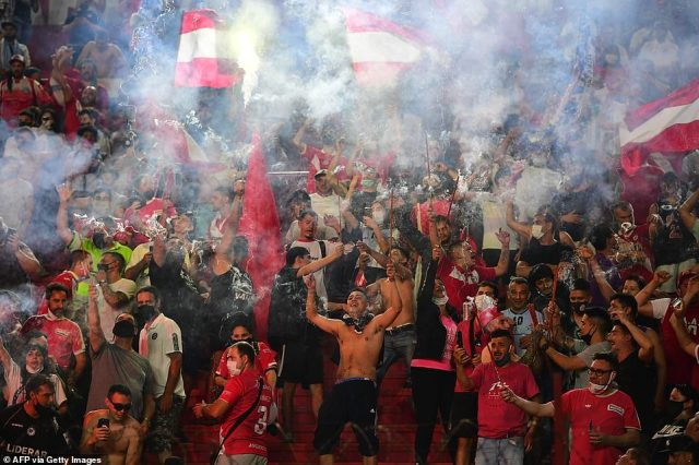 Grieving fans let off flares at the Argentinos Juniors stadium where Maradona began his professional career in the 1970s