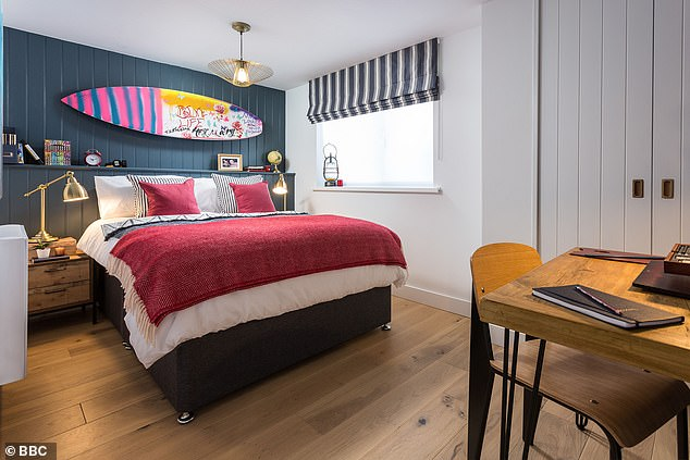 Fit for a teenager: Sneak peek photos reveal how one of the boys has been given his own double bed in a beach-inspired room, complete with a surfboard hung on the wall