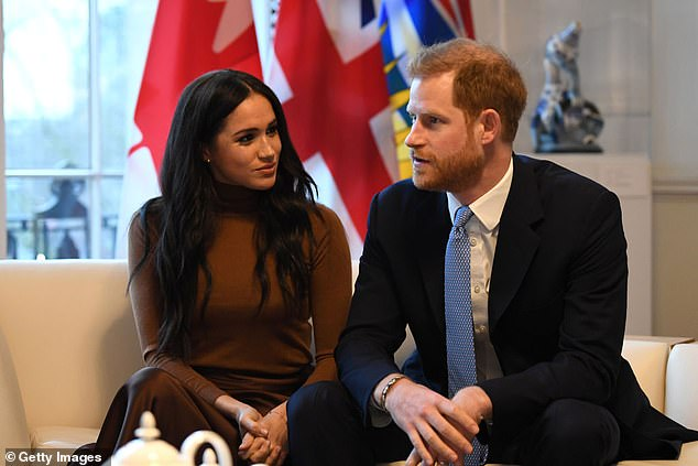 'Hours later, I lay in a hospital bed, holding my husband's hand. I felt the clamminess of his palm and kissed his knuckles, wet from both our tears,' she wrote. Pictured with husband, Prince Harry in London in January