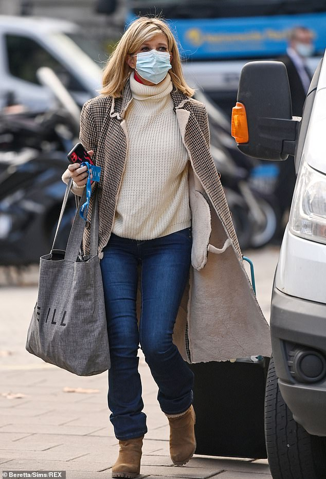 Out and about: Kate Garraway headed to work at Smooth Radio in London on Thursday after admitting she feels 'sick' at the prospect of facing her first Christmas without her husband