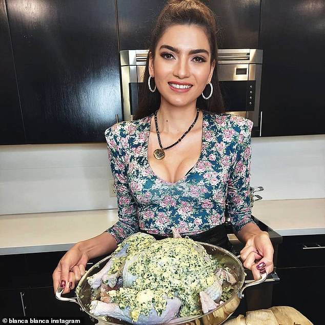 What's cooking good looking?Blanca Blanco, who will next be seen in Tale Of Tails, was seen at home in a plunging top and owl locket necklace from Giparse Jewelry, available on Etsy