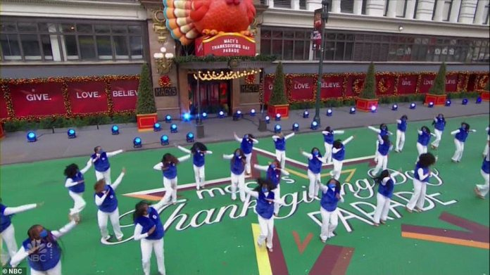 One of the dance troupes performs on Thursday morning despite the rain