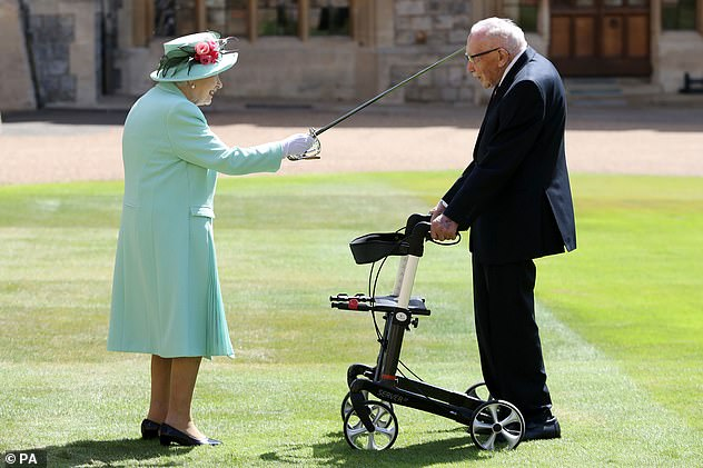 Captain Sir Tom Moore is pictured being knighted by the Queen in July during a ceremony at Windsor