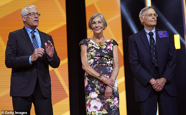 Walmarts owners, the Walton family, have also been criticized for failing to protect their workers during the pandemic. PicturedRob, Alice and Jim Walton speak in 2018
