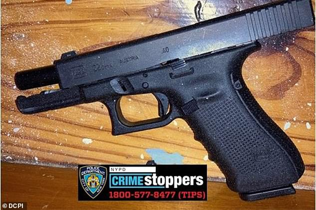 Officials said they recovered two of Goppy's handguns (pictured) at the scene, including a Glock