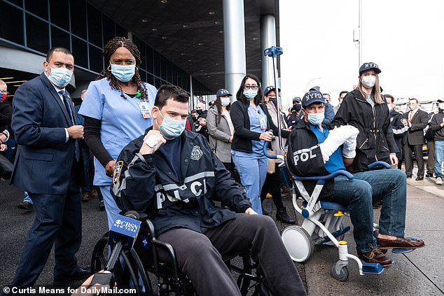 The two NYPD cops shot during a domestic violence incident this week left hospital to a hero's welcome Thursday